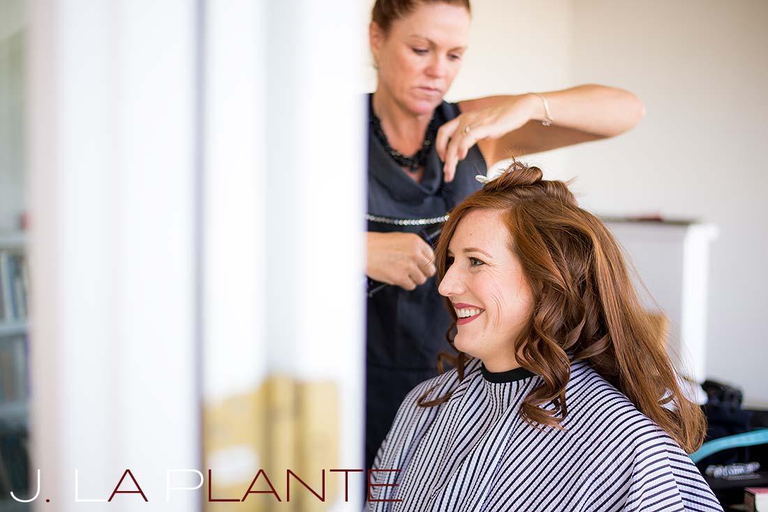 J. La Plante Photo | Aspen Wedding Photography | Aspen Meadows Resort Wedding | Bride getting hair done
