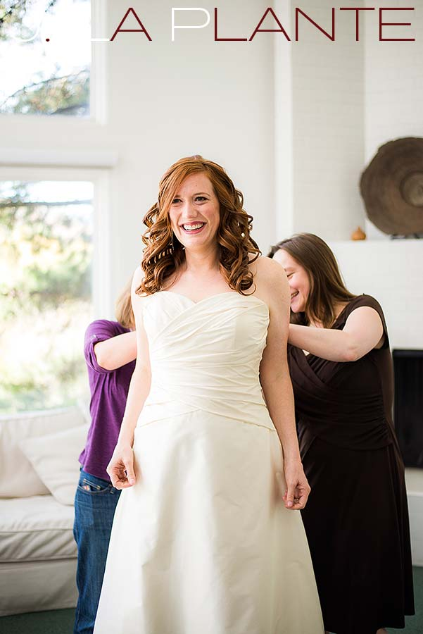 J. La Plante Photo | Aspen Wedding Photography | Aspen Meadows Resort Wedding | Bride getting into dress