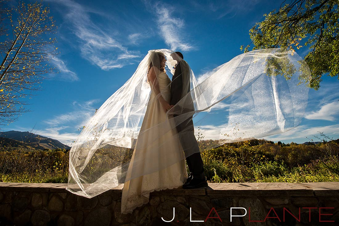 J. La Plante Photo | Aspen Wedding Photography | Aspen Meadows Resort Wedding | Bride and groom under veil
