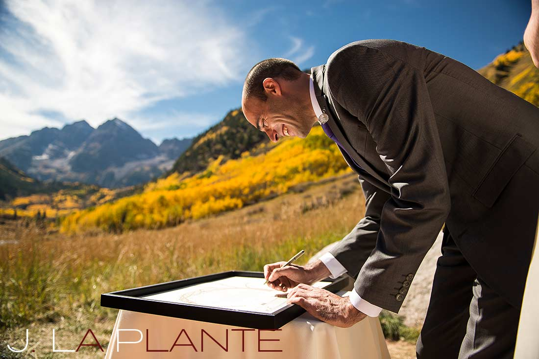 J. La Plante Photo | Aspen Wedding Photography | Maroon Bells Wedding | Groom signing ketubah