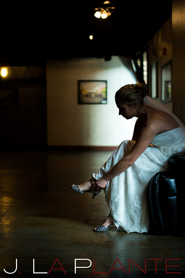 bride putting on her shoes before wedding
