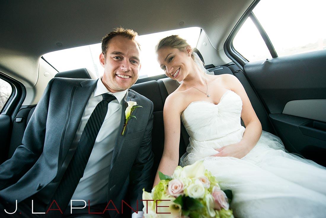 Bride and groom in car   Mile High Station Wedding   Denver Wedding Photographer   J. La Plante Photo