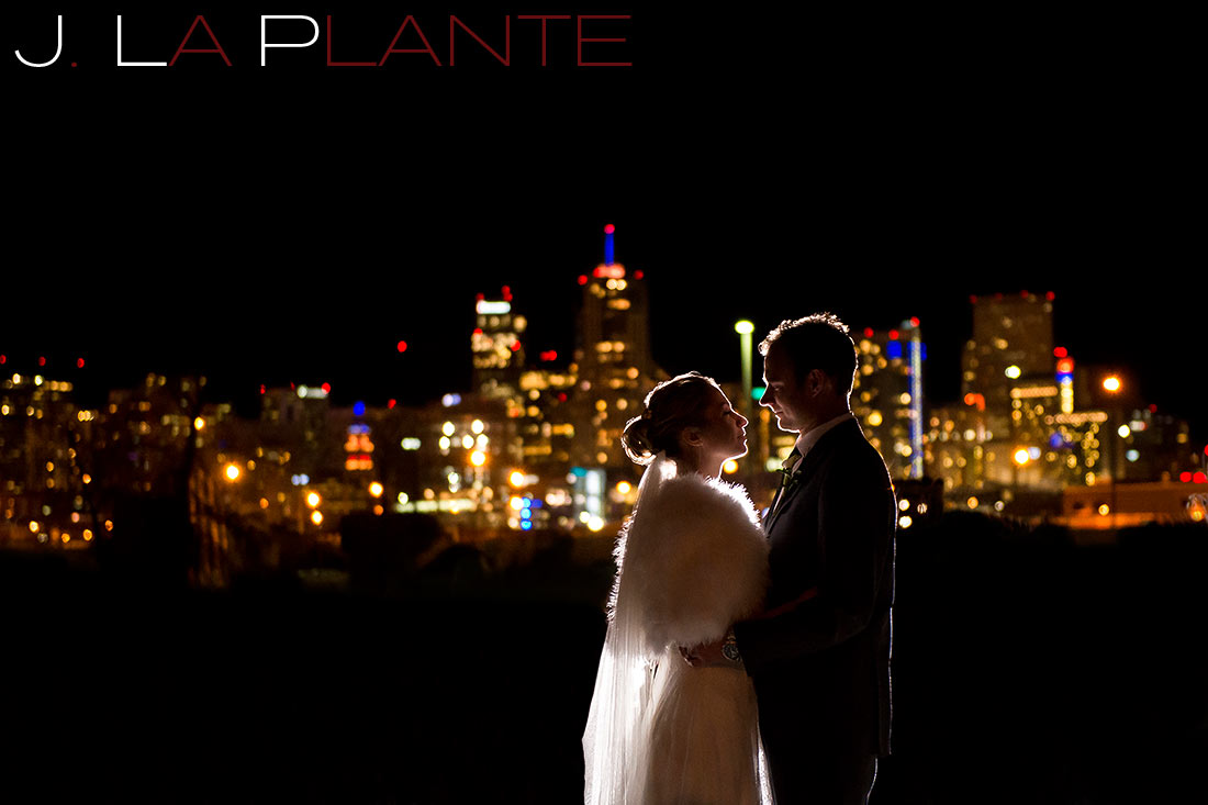 bride and groom with the denver skyline