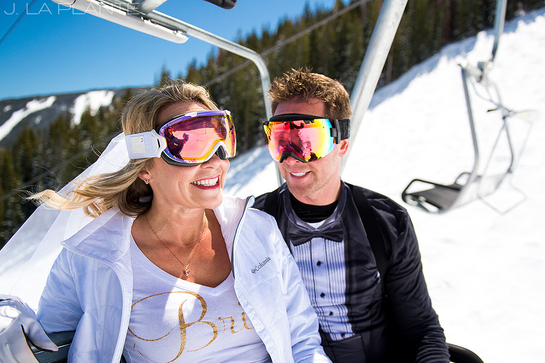 J. LaPlante Photo | Eagle County Wedding Photographer | Beaver Creek Mountain Wedding | Snowboarding Bride And Groom On Chairlift