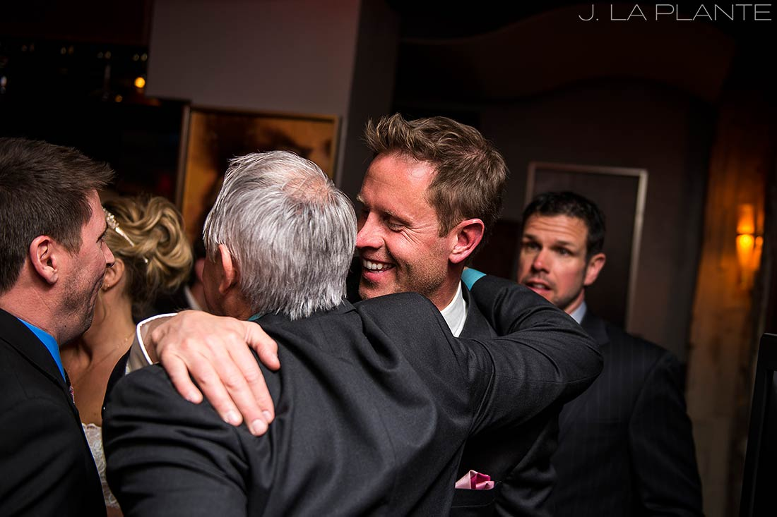 J. LaPlante Photo | Colorado Wedding Photographer | Beaver Creek Lodge Wedding | Groom Hugging Father