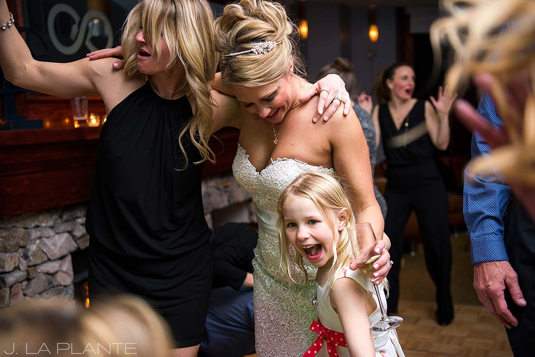 J. LaPlante Photo | Colorado Wedding Photographer | Beaver Creek Lodge Wedding | Bride And Flower Girl Dancing
