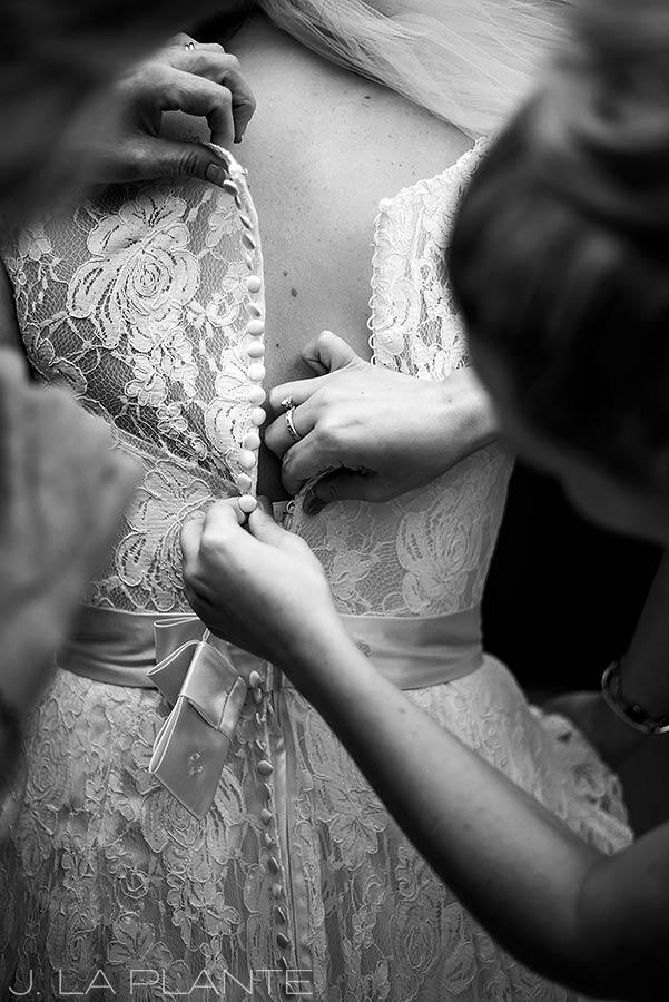 J. La Plante Photo | Denver Wedding Photographer | University of Denver Wedding | Fritz Knoebel Wedding | Bride Getting Into Dress