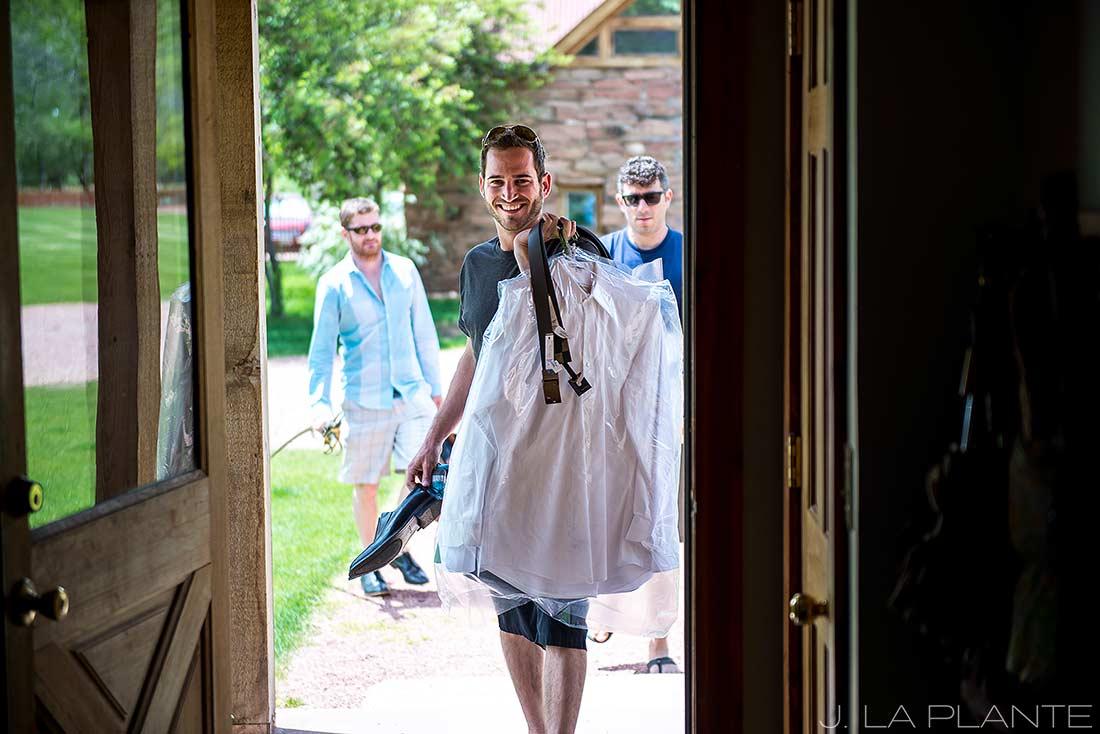 J. La Plante Photo | Boulder Wedding Photographer | Planet Bluegrass Wedding | Groom Arriving On Scene