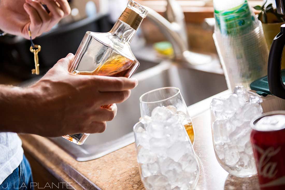 J. La Plante Photo | Boulder Wedding Photographer | Planet Bluegrass Wedding | Groomsmen Drinking Whiskey