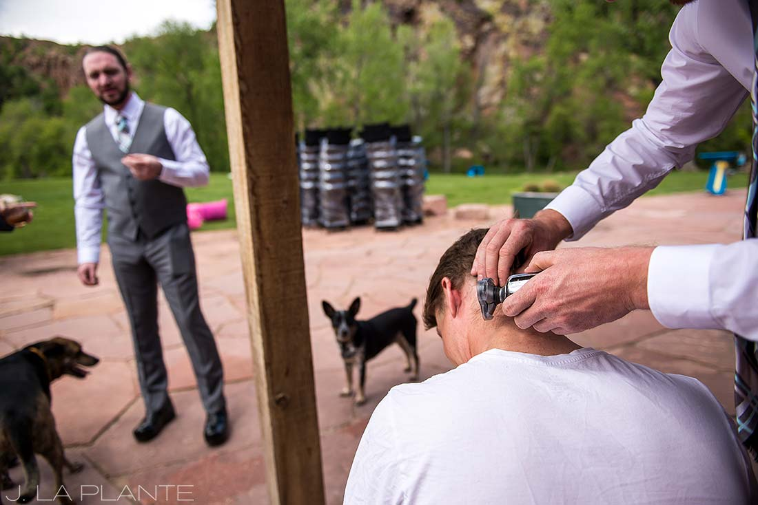 J. La Plante Photo | Boulder Wedding Photographer | Planet Bluegrass Wedding | Groomsman Getting His Head Shaved