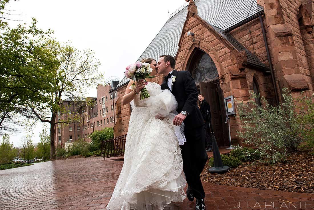 snowy colorado wedding bride and groom leaving church