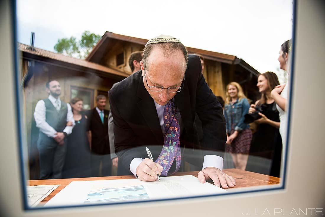 J. La Plante Photo | Boulder Wedding Photographer | Planet Bluegrass Wedding | Rabbi Signing Ketubah