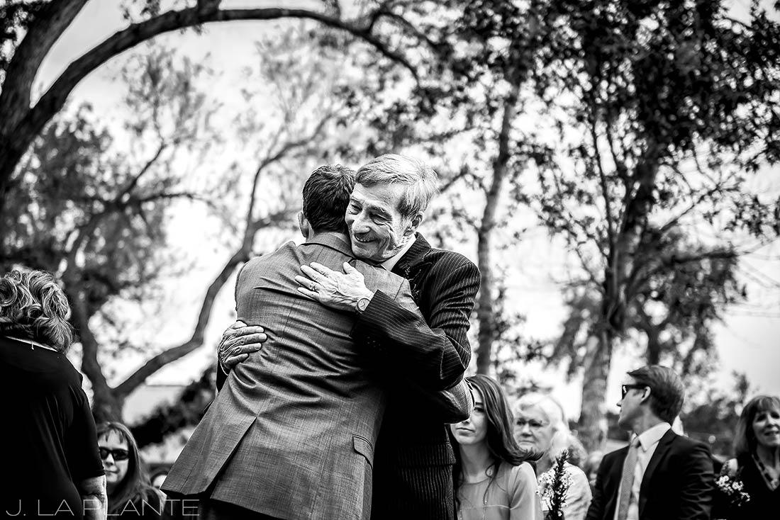 J. La Plante Photo | Boulder Wedding Photographer | Planet Bluegrass Wedding | Groom Hugging Father