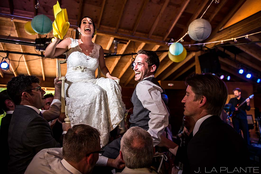 J. LaPlante Photo | Boulder Wedding Photographer | Planet Bluegrass Wedding | Bride and groom in chairs during hora