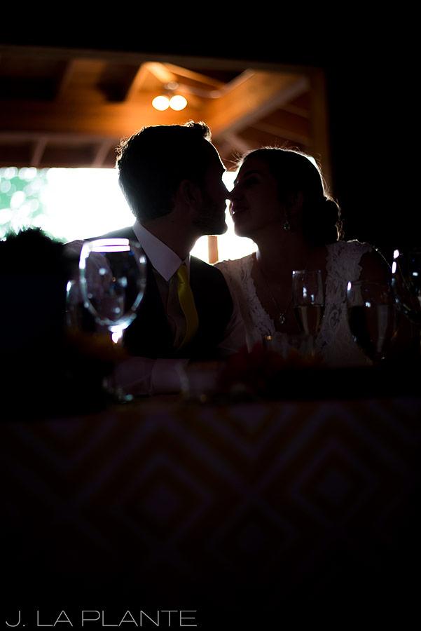 J. La Plante Photo | Boulder Wedding Photographer | Planet Bluegrass Wedding | Bride and groom kissing