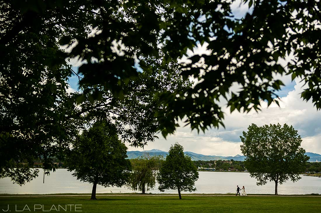J. La Plante Photo | Denver Wedding Photographer | Sloan's Lake Park Wedding | Bride and Groom Walking by Lake