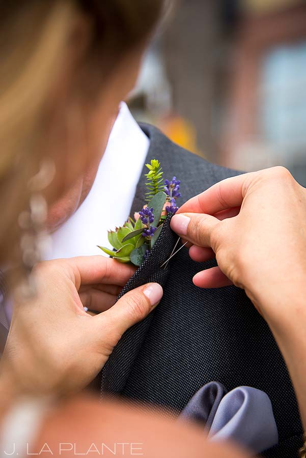 J. La Plante Photo | Denver Wedding Photographer | River North Art District Wedding | Bride Pinning Boutonniere on Groom