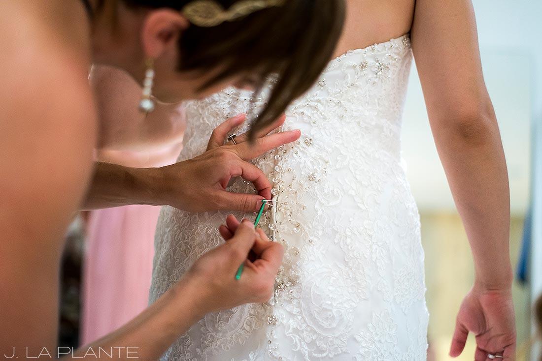 J. LaPlante Photo | Lyons Wedding Photographer | Mon Cheri Wedding | Bride Getting Into Dress