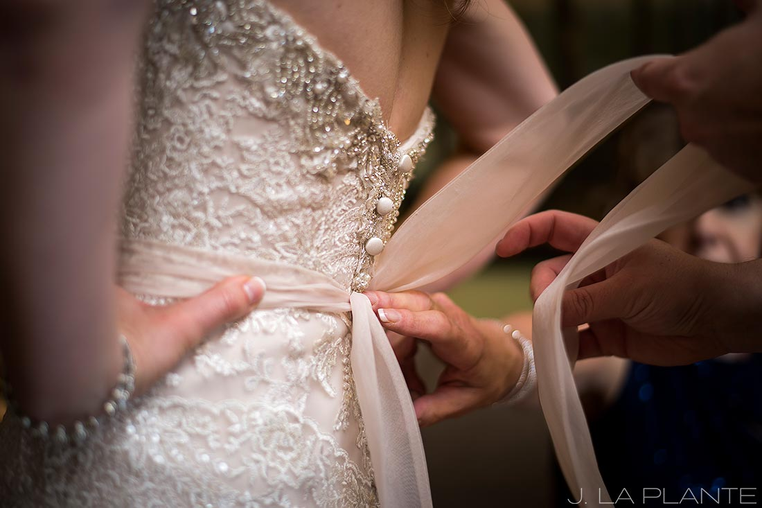 J. LaPlante Photo | Colorado Springs Wedding Photographers | Cheyenne Mountain Resort Wedding | Bride Getting Into Dress