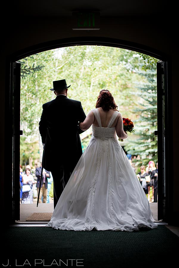 J. La Plante Photo   Vail Wedding Photographers   Vail Interfaith Chapel Wedding   Bride and Groom Leaving Church