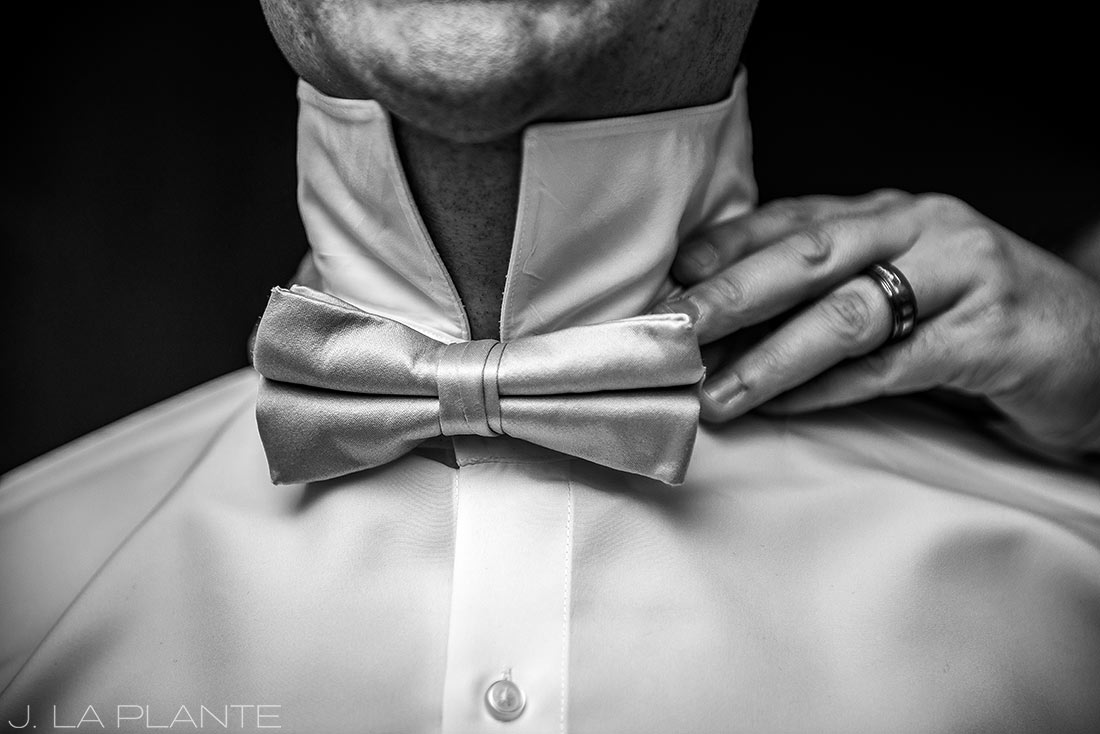 J. LaPlante Photo | Colorado Springs Wedding Photographers | Cheyenne Mountain Resort Wedding | Groom Getting Help with Bow Tie