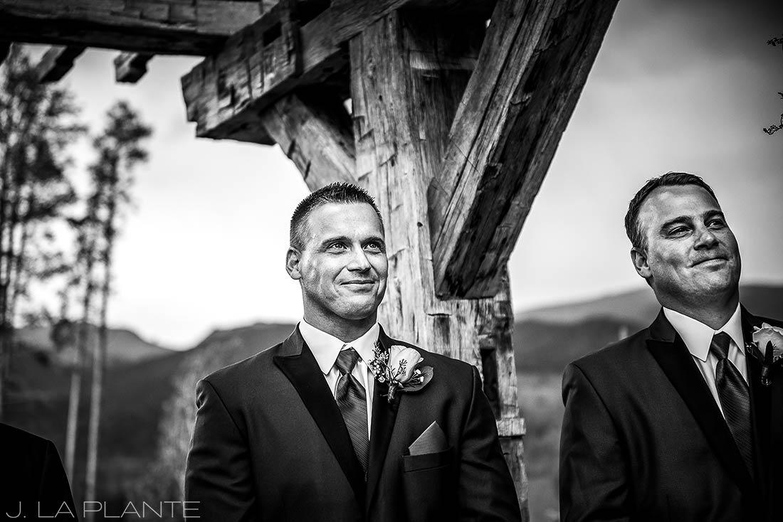 J. La Plante Photo | Winter Park Colorado Wedding Photographer | Devil's Thumb Ranch Wedding | Groom Watching Bride Walk Down Aisle