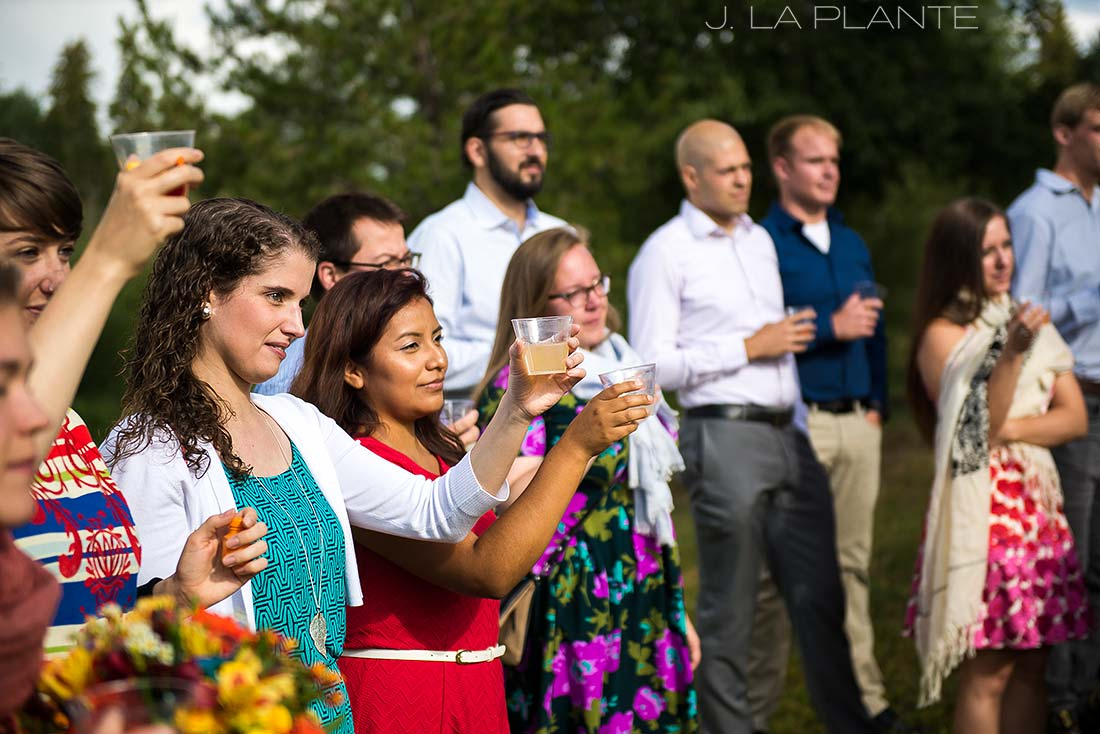 J. La Plante Photo | Rocky Mountain Wedding Photographer | Shadow Mountain Ranch Wedding | Wedding Guests Toasting