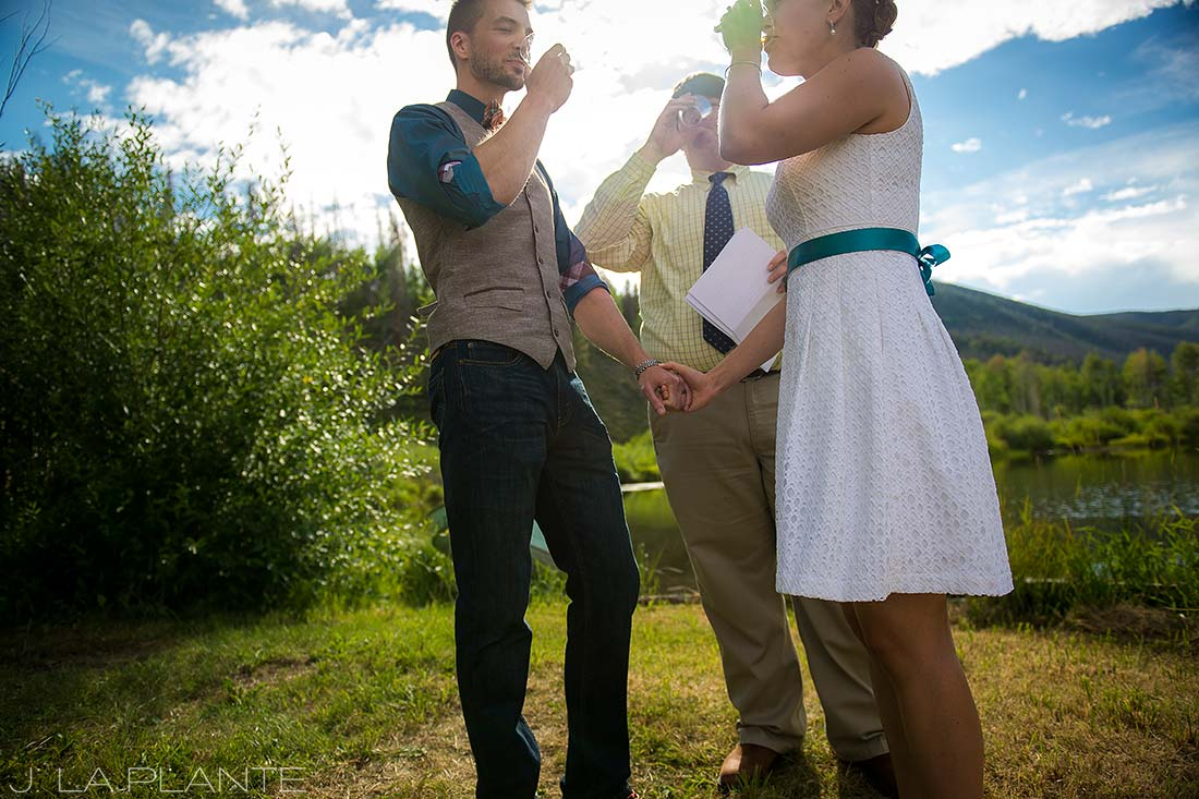 J. La Plante Photo | Rocky Mountain Wedding Photographer | Shadow Mountain Ranch Wedding | Bride and Groom Drinking Whiskey