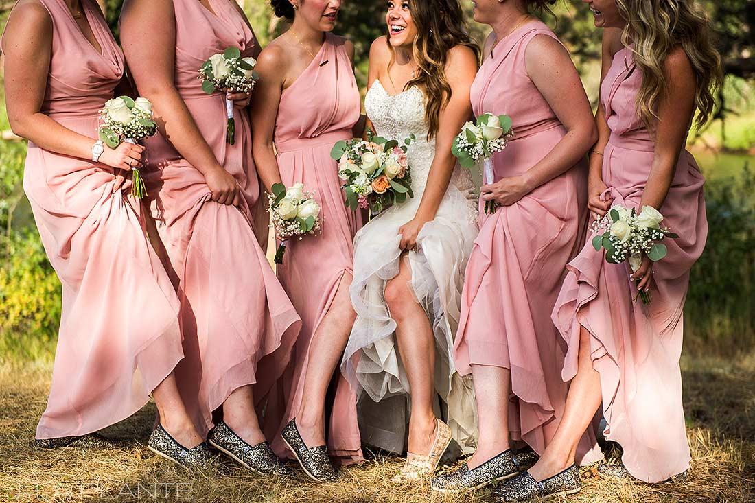 J. LaPlante Photo | Boulder Wedding Photographer | Mon Cheri Wedding | Bridesmaids Lifting Up Dresses