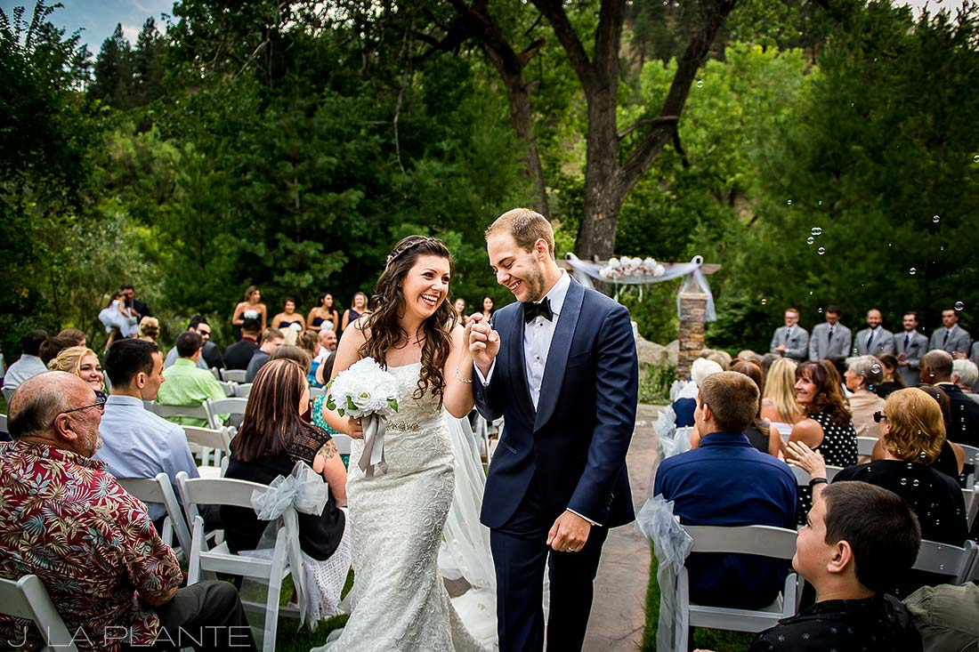 J. La Plante Photo | Boulder Wedding Photographers | Wedgewood on Boulder Creek Wedding | Bride and Groom Exiting Ceremony