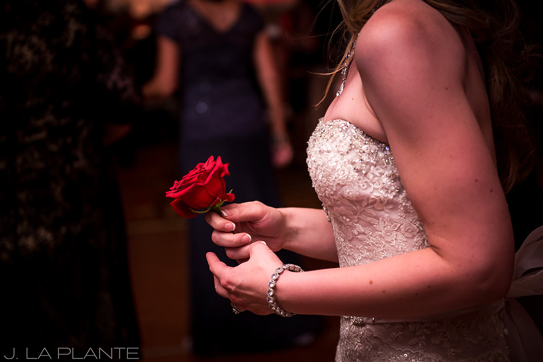 J. LaPlante Photo | Colorado Springs Wedding Photographers | Cheyenne Mountain Resort Wedding | Bride Holding Rose