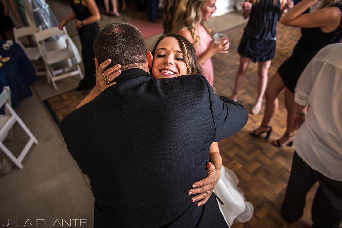 J. LaPlante Photo | Colorado Wedding Photographer | Mon Cheri Wedding | Bride Hugging Wedding Guest