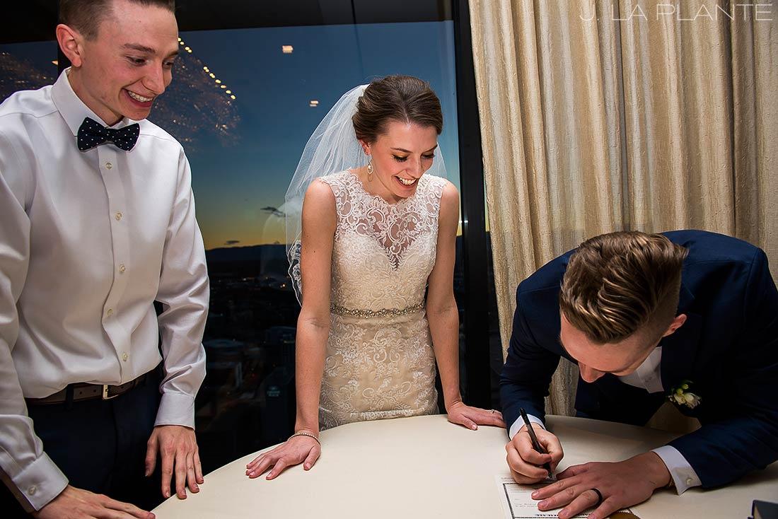 J. La Plante Photo | Denver Wedding Photographer | Grand Hyatt Wedding | Bride and groom signing marriage license