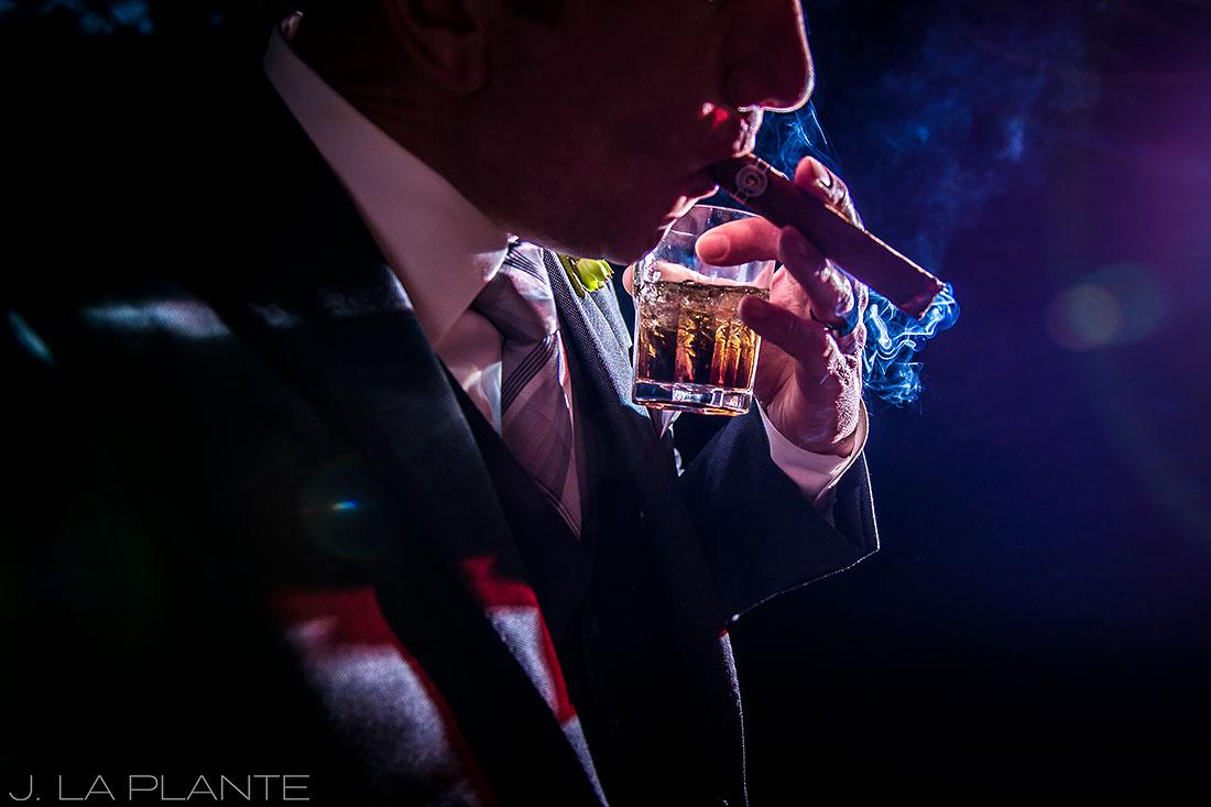 J. La Plante Photo | Denver Wedding Photographers | Chatfield Botanic Gardens Wedding | Groom Smoking Cigar Drinking Whiskey
