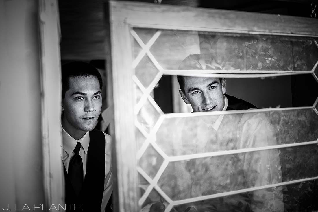J. La Plante Photo | Colorado Wedding Photographers | River Bend Wedding | Groomsmen Looking out for Bride