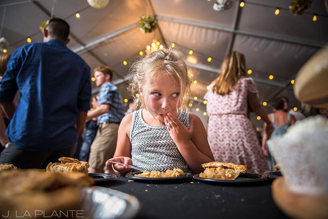 J. LaPlante Photo | Colorado Wedding Photographers | Mon Cheri Wedding | Flower Girl Sneaking Cake