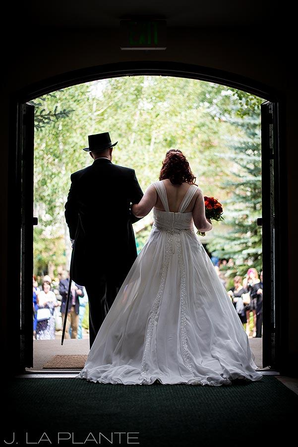 J. LaPlante Photo | Vail Wedding Photographers | Vail Interfaith Chapel Wedding | Bride and Groom Leaving Church