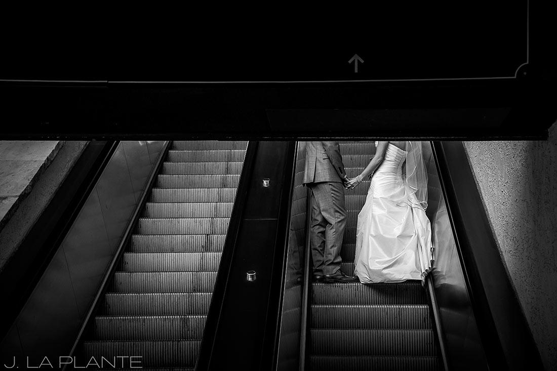J. LaPlante Photo | Beaver Creek Wedding Photographers | Beaver Creek Wedding | Bride and Groom on Escalator