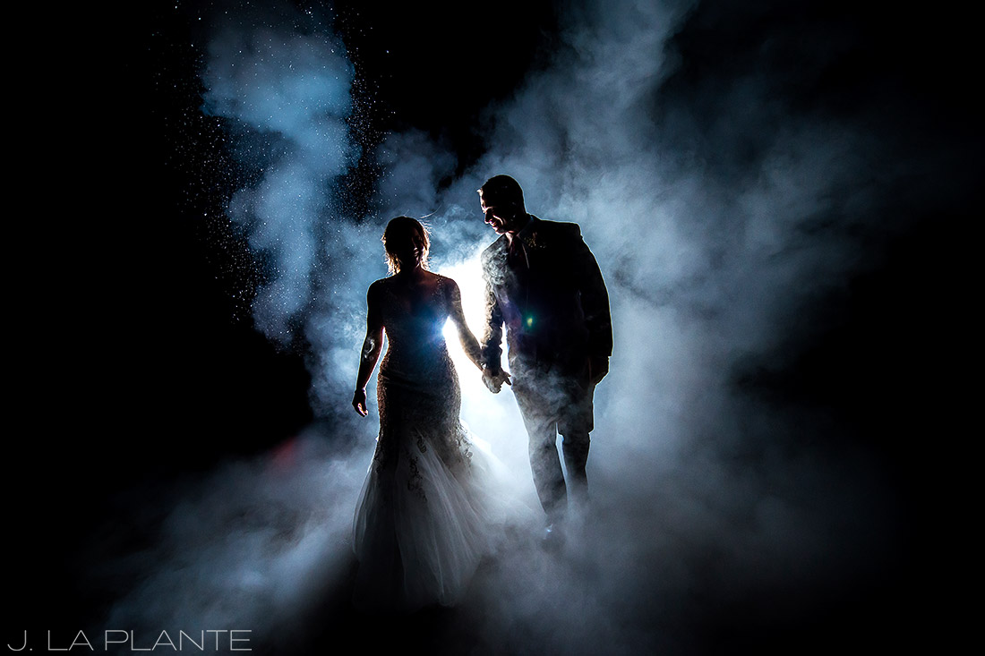 J. LaPlante Photo | Colorado Wedding Photographers | Devil's Thumb Ranch Wedding | Bride and Groom Fire Extinguisher Portrait