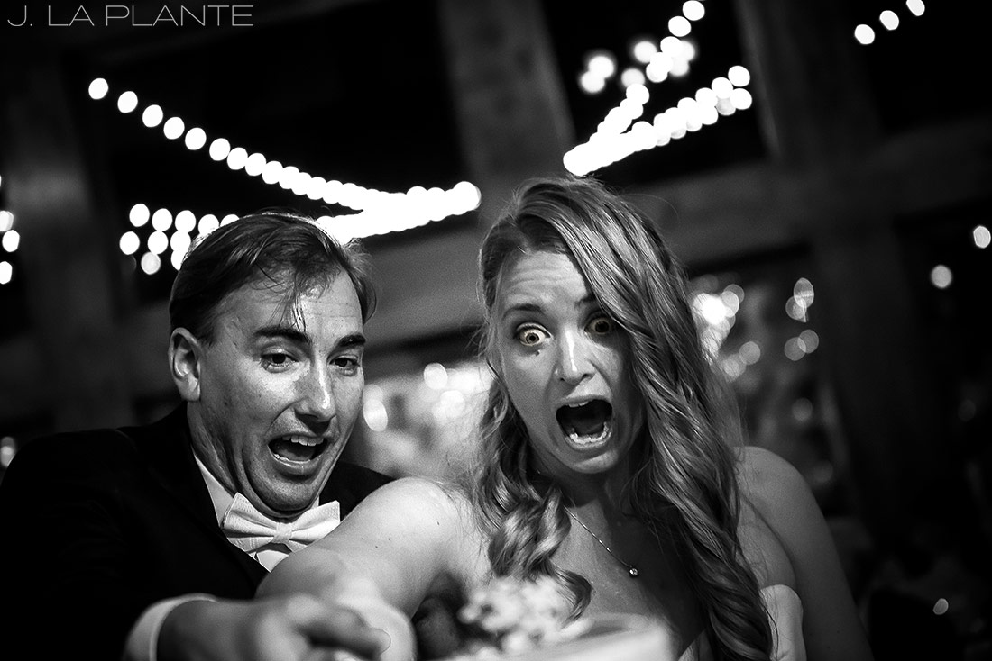 J. LaPlante Photo | Estes Park Wedding Photographers | Della Terra Wedding | Bride and Groom Cutting Cake