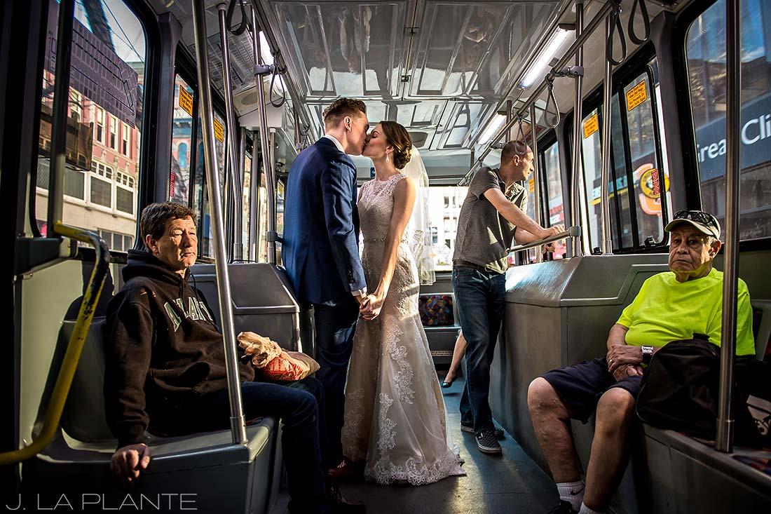 J. LaPlante Photo | Denver Wedding Photographers | Grand Hyatt Denver Wedding | Bride and Groom on 16th Street Mall Ride