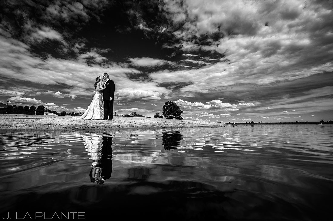 black and white portrait of bride and groom on beach