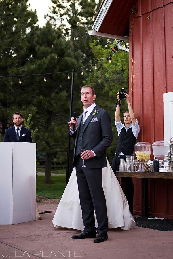groom giving a speech at wedding reception