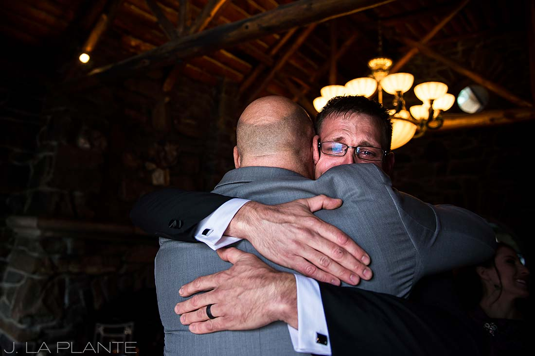 Groom hugging best man | Chief Hosa Lodge wedding | J. La Plante Photo | Denver Wedding Photographers