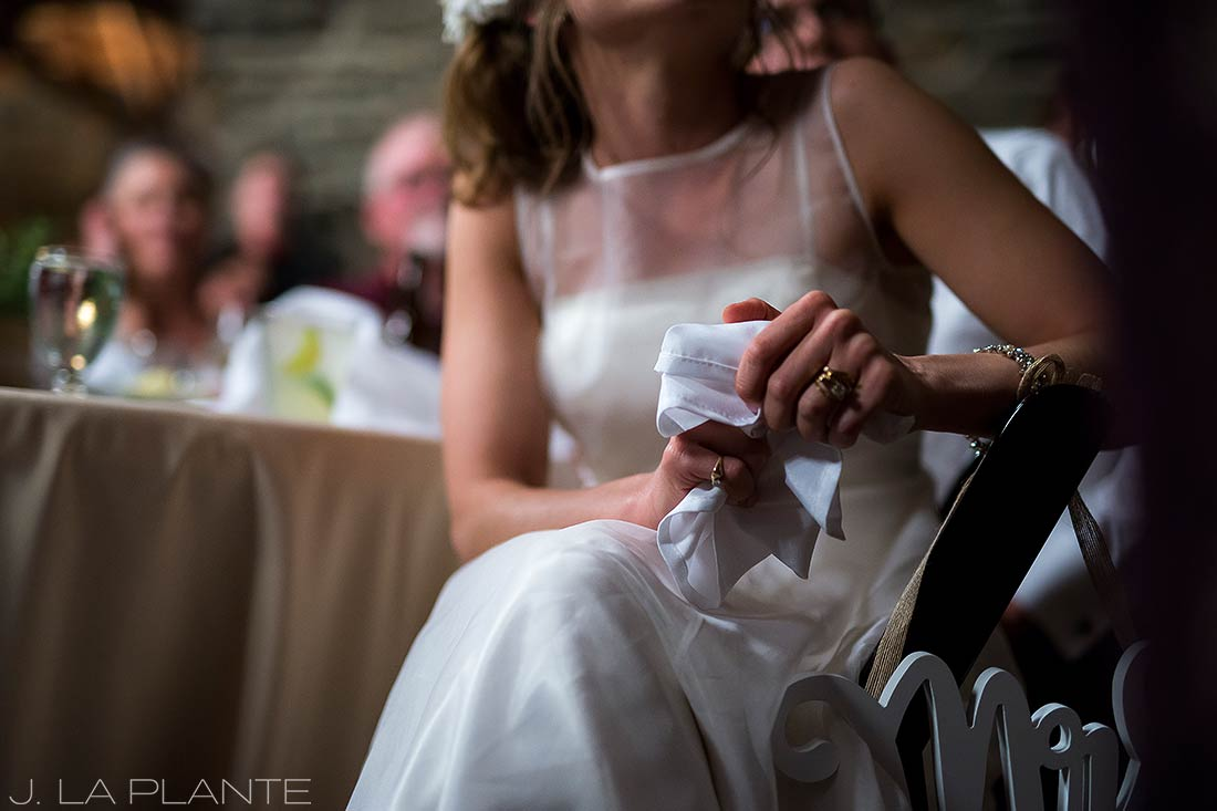 Bride during toasts | Chief Hosa Lodge wedding | J. La Plante Photo | Denver Wedding Photographers