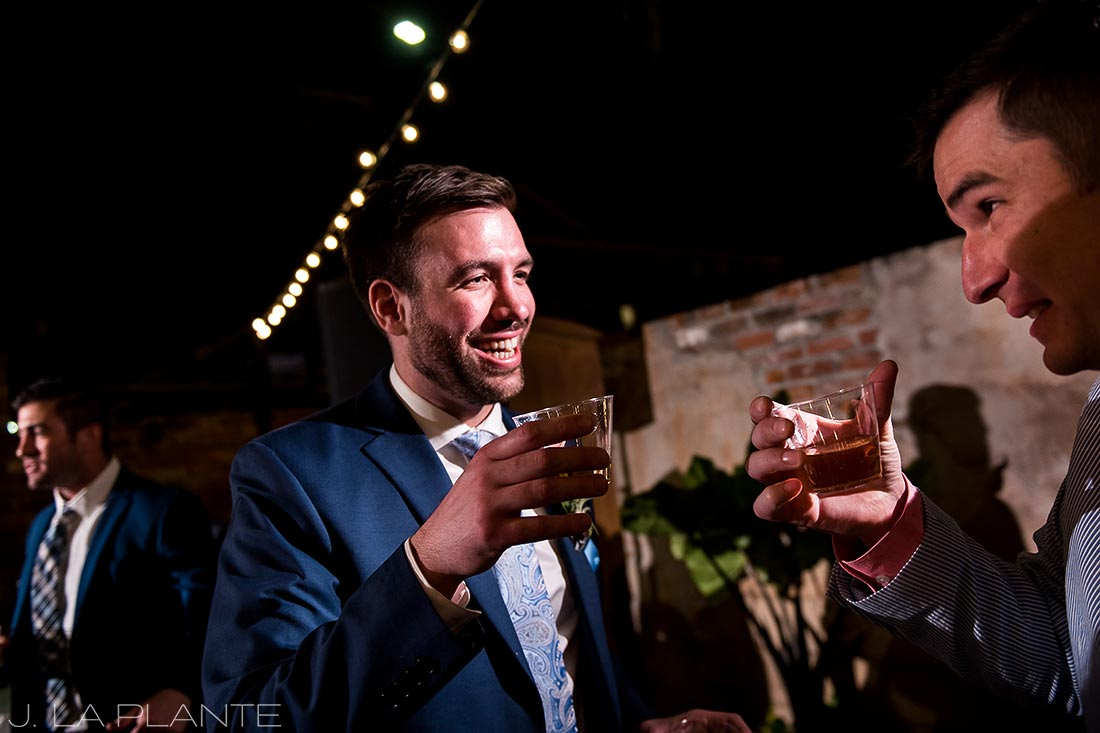 Groom drinking whiskey | Race & Religious Wedding | New Orleans Destination Wedding Photography | J. La Plante Photo