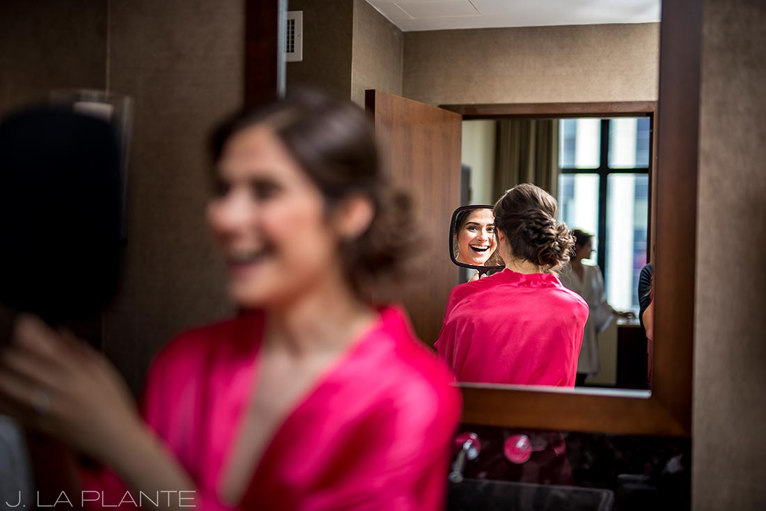 Grand Hyatt Denver Wedding | Bride looking in mirror | Same Sex Wedding Photographer | J La Plante Photo