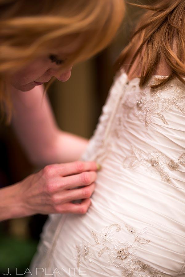 Mount Vernon Country Club Wedding | Bride getting into dress | Denver wedding photographer | J La Plante Photo