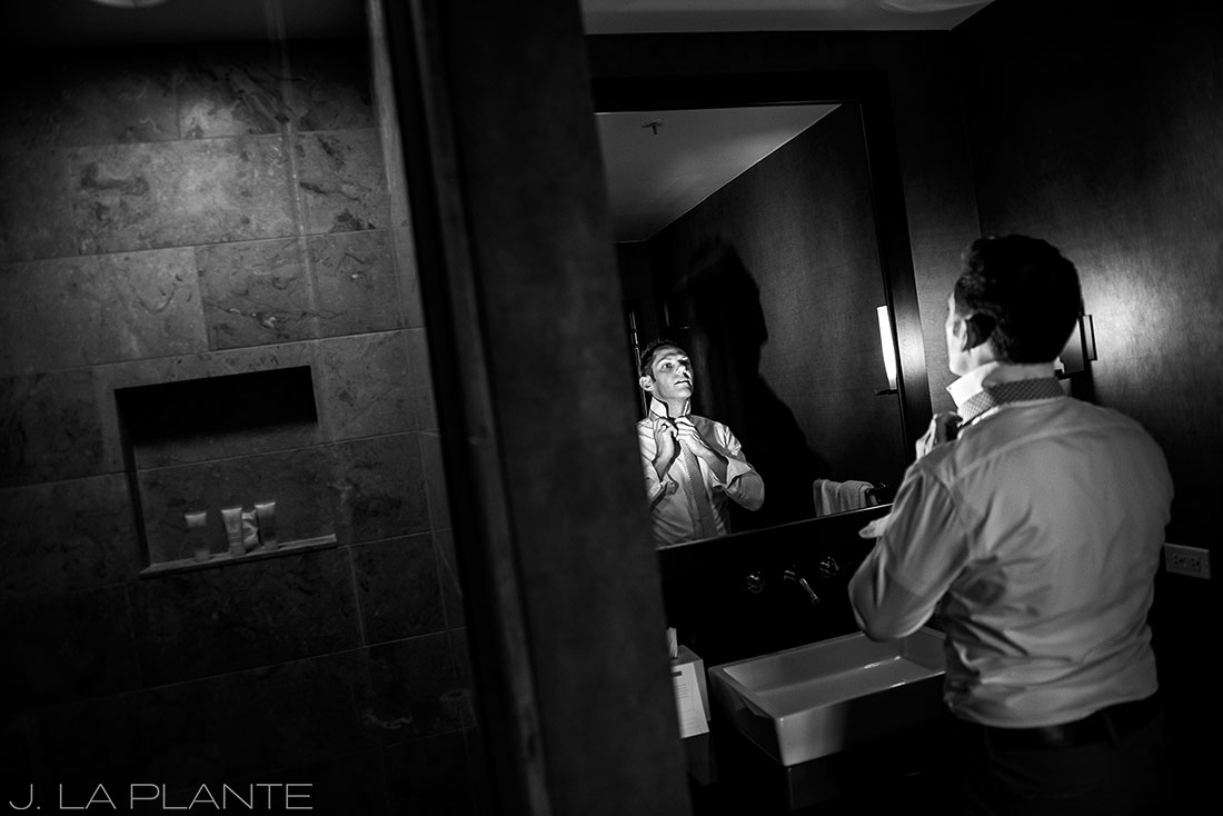 Grand Hyatt Denver Wedding | Bridesman adjusting tie | Same Sex Wedding Photographer | J La Plante Photo