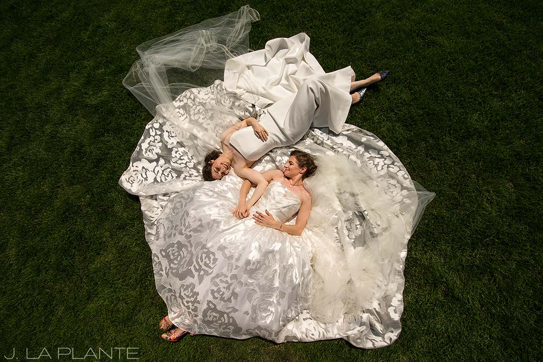 Denver Botanic Gardens Wedding | Brides lying on wedding dress | Same Sex Denver Wedding Photographer | J La Plante Photo